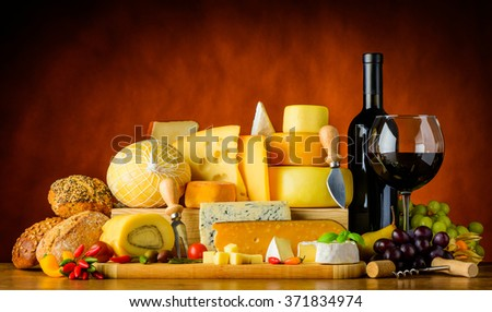 Bottle and Glass red wine with cheese, bread and food