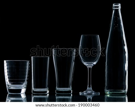Bottle and Glass water clear isolate on over black background - stock photo