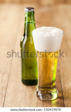 bottle and glass with beer - stock photo