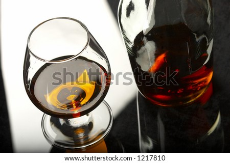 bottle and glasses of brandy