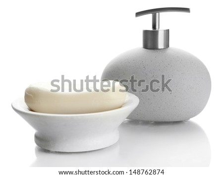 Bottle and soap-dish with soap isolated on white - stock photo