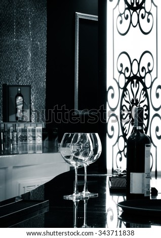Bottle and two glasses of red wine together on a tray served - stock photo