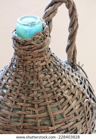 bottle antique Wicker-clad to hold wine and oil - stock photo