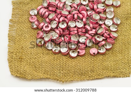 Bottle cap vaccine  aluminum , aluminum plastic use for prostheses in  brown sack fabric  on white background - stock photo