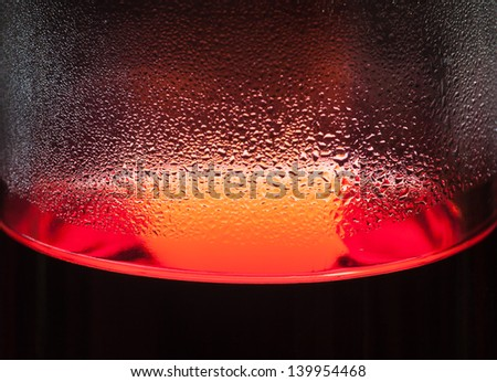 Bottle condensation red liquid abstract - stock photo