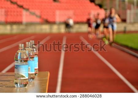 Bottle during athletics race - stock photo