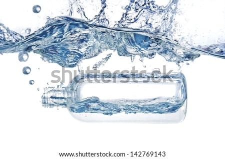 bottle falling  and sinking in blue water