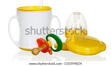 Bottle for children and dummy. - stock photo