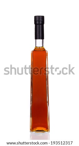 Bottle full of brandy. Isolated on a white background.