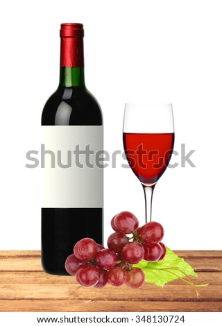 bottle, glass of red wine and grape on wooden table isolated on white background