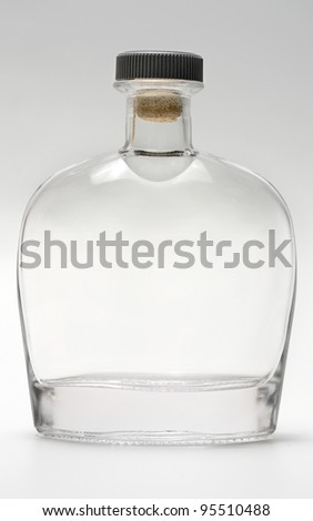 bottle glass reflection on gray background - stock photo