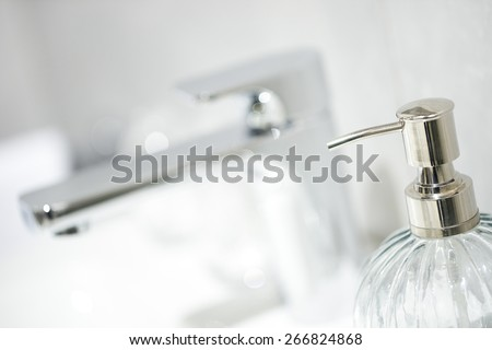 bottle liquid soap and water tap - stock photo