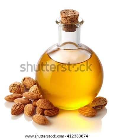 Bottle of almond oil isolated on white background - stock photo