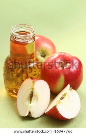 bottle of apple juice and some fresh apples