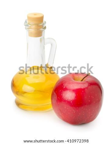 bottle of apple vinegar and apple isolated on white - stock photo