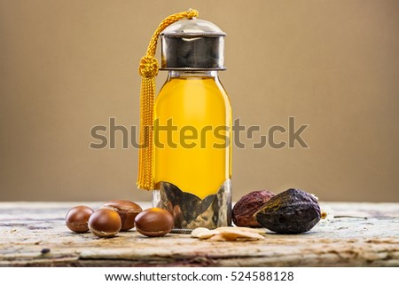 Bottle of argan oil and fruits for skin care