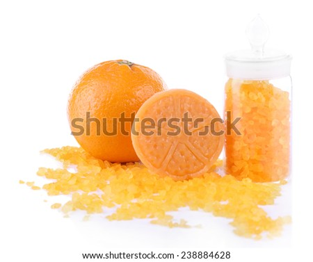 Bottle of bath salt with fresh orange and bar of soap isolated on white - stock photo