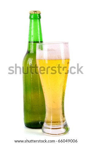 Bottle of beer and cup isolated on white