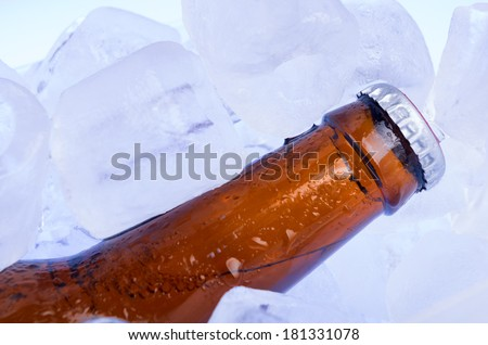 Bottle of beer in ice - stock photo