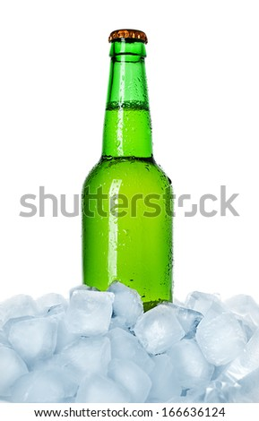 bottle of beer on ice isolated - stock photo
