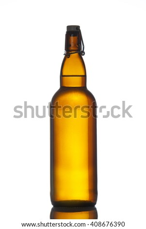 Bottle of beer with drops isolated