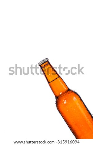 Bottle of beer with drops on white background