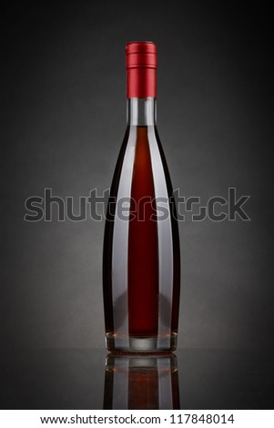 bottle of brandy or cognac isolated on black - stock photo