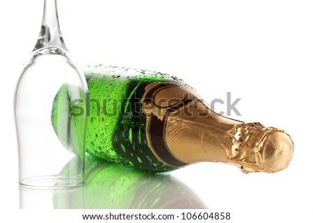 Bottle of champagne and goblet isolated on white - stock photo