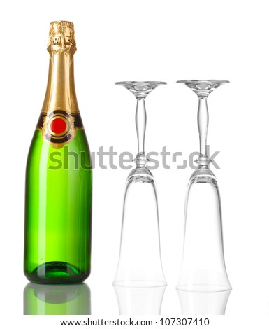 Bottle of champagne and goblets isolated on white - stock photo