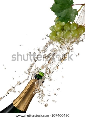 Bottle of champagne and grapes splash