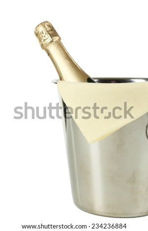 Bottle of champagne in a bucket on white background