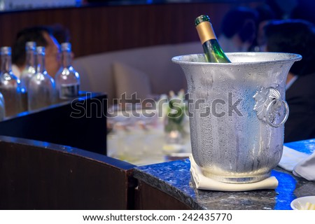 Bottle of champagne in bucket - stock photo