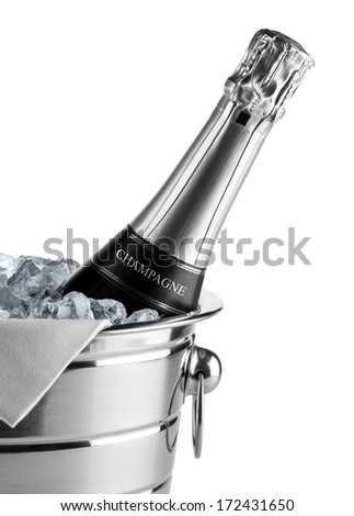 bottle of champagne in cooler - stock photo