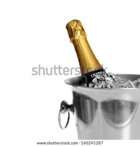 Bottle of champagne in cooler over white