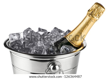 bottle of champagne in cooler with ice cubes