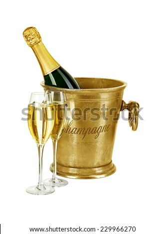 Bottle of champagne  in ice bucket with stemware isolated on white background - stock photo