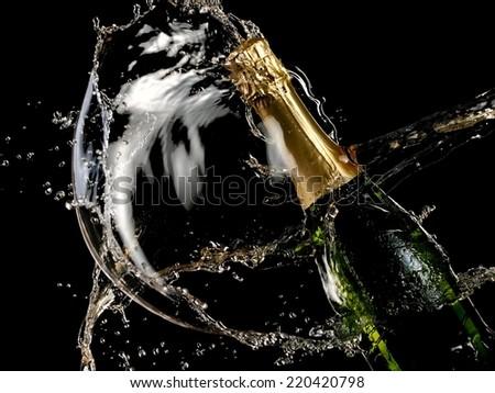 Bottle of champagne splash - stock photo