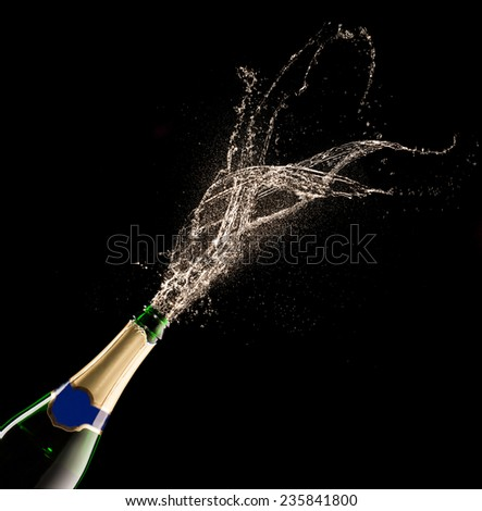 Bottle of champagne with splash isolated on black background