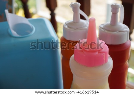 Bottle of chili sauce and ketchup - stock photo