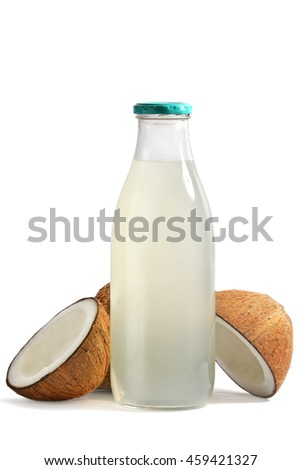 bottle of coconut water with fresh coconut fruits on a white background