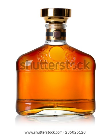 Bottle of cognac isolated on a white background - stock photo