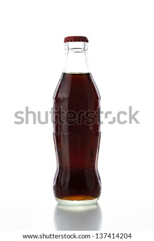 Bottle of cola with ice on a white background - stock photo