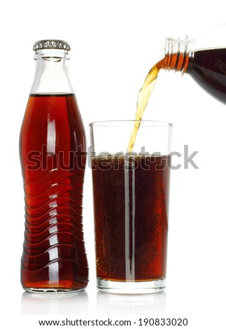 Bottle of cola with pouring into glass on white background - stock photo