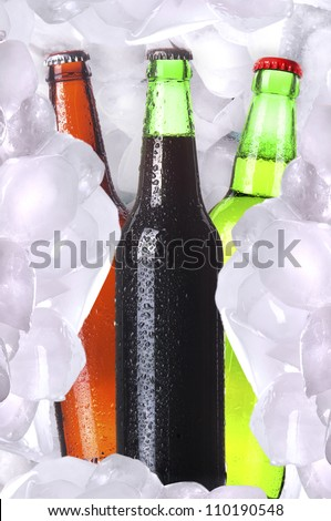 Bottle of cold beer is in ice - stock photo