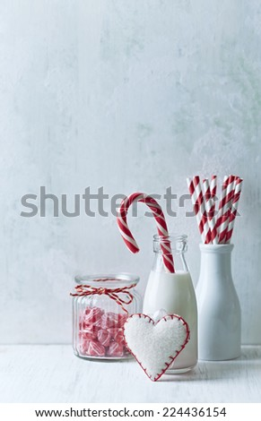 Bottle of cold milk and Christmas candy - stock photo
