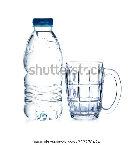bottle of drinking water and empty glass on white background - stock photo