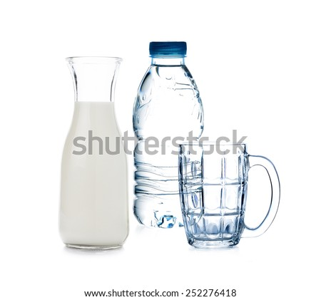 bottle of drinking water and milk with empty glass on white background - stock photo