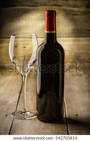 Bottle of dry red wine with a glass