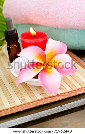 Bottle of essential oil, towel,candles and flower for simple spa concept
