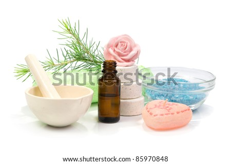 Bottle of fir tree essential oil and spa salt tablets on white background